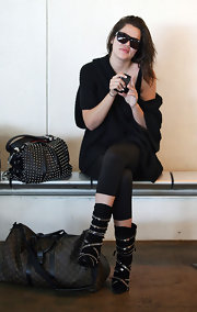 "Khloe adds these black ""Cindy"" sunglasses to her all black airport outift."