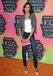 Zoe Saldana added a dash of color to her outfit with a pink stripped buckle clutch. It was a nice way to bring a little fun to her classic outfit.