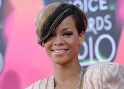 Hair chameleon Rihanna changed up her look again for the Kids Choice Awards, where she donned a highlighted blonde side-wept look.