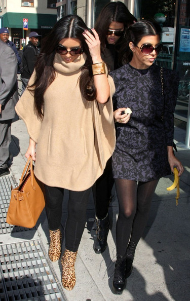 The Kardashian sisters Kim Kourtney and Khloe step out of their hotel to