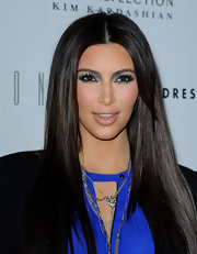 Kim Kardashian attended the launch of her fragrance wearing bright aqua blue eyeshadow and long false lashes.