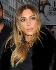 Kim Kardashian styled her hair with a center part and feathery ends for a day out in Paris.
