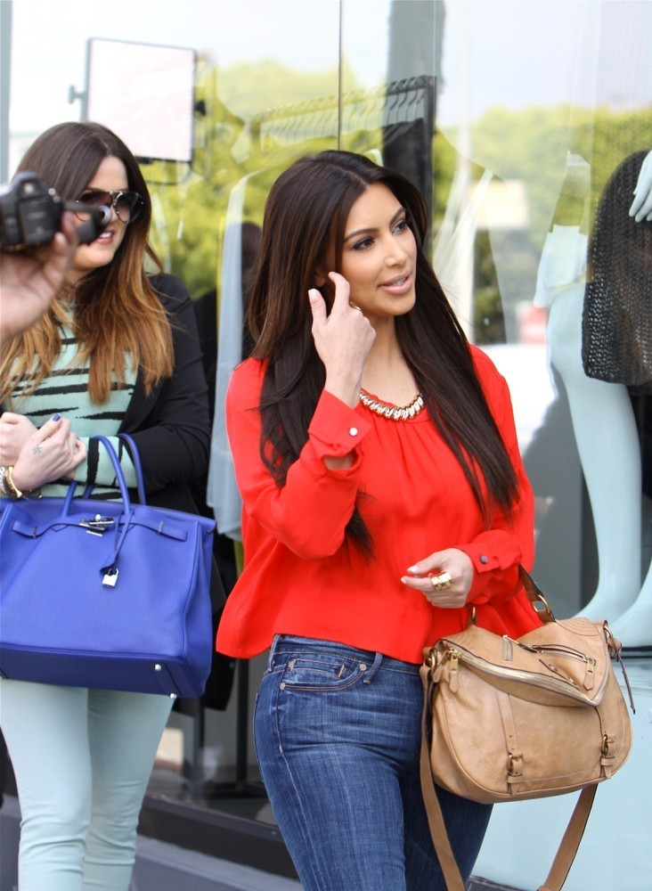 Kim Kardashian Carried This Leather Bag While Out Ping With Her Sister