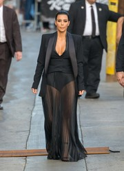 Kim Kardashian put her pins on display in a sheer black Balmain maxi skirt while headed to 'Jimmy Kimmel.'