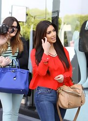 Kim Kardashian carried this nude leather bag while out shopping with her sister.