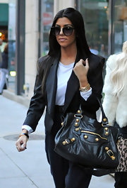 Kourtney showed off her leather City bag while hitting the streets of NYC, with sister Kim.