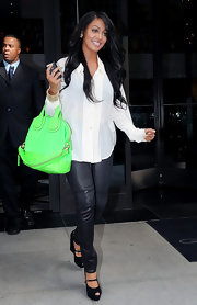 La La Anthony completed her stylish ensemble with a pair of black peep-toe wedges.
