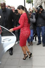 Kim Kardashian leaves to attend her fragrance launch wearing her hair in a long sleek ponytail.