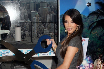 Kim Kardashian Cuts the Toilet Paper at Charmin's Restroom Ribbon Ceremony