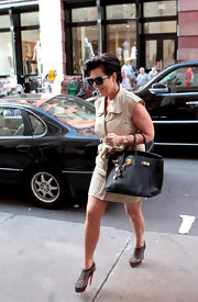 Looking just like her daughters Kris Jenner showed off her style in a khaki dress and a coveted Birkin bag.
