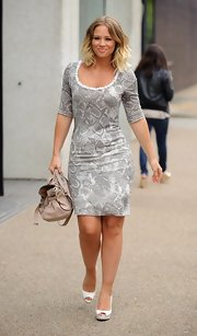 Kimberley Walsh sported this pale gray snakeskin frock with an embellished scoop neckline while out in London.