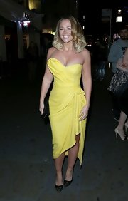 Kimberley Walsh's glamorous yellow strapless dress went perfectly with her voluptuous figure.