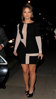 Kimberley Walsh showed just a peek of skin with this long-sleeve frock that featured sheer mesh geometric cutouts.