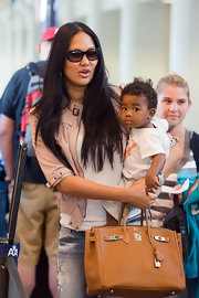 "Kimora Lee Simmons showed off her cute baby boy Kenzo, while in LAX Airport. Of course she couldn't forget her handy ""Birkin"" bag."