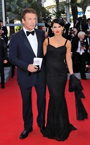 Hilaria Thomas vamped it up at the Cannes Film Festival in this black gown and red lips.