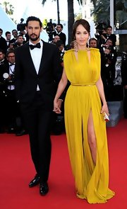 Dolores Chaplin was simply breathtaking at the Cannes Film Festival in this chartreuse gown with dramatic slits.