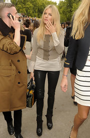 Sienna Miller completed her look at London Fashion Week with a nude cropped cardigan.
