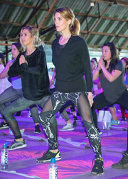 Ashley Greene covered up in a black V-neck sweater for the Kohl's x Studio Tone It Up event.