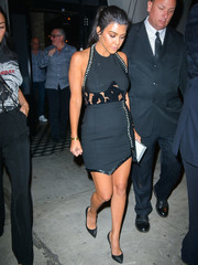 Kourtney Kardashian kept the sexy vibe going with an asymmetrical mini skirt, also by Mugler.