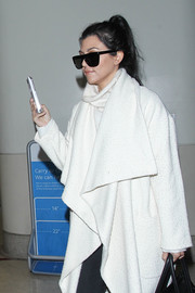 Kourtney Kardashian hid her eyes behind a pair of top-heavy sunglasses as she made her way through LAX.
