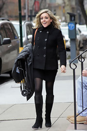 Jane looked polished and warm in black suede boots with leather cuffs.