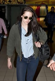 Kristen Stewart maintained her tom boyish style in an olive parka and chambray button up.