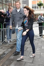 Kristen Stewart stepped into a pair of plaid loafers for a visit to Radio 1 in London.