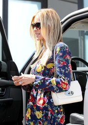 Kristin Cavallari was spotted out in Beverly Hills sporting a chic white chain-strap bag with a floral outfit.