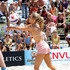 Joanna Krupa strips down to her bikini top as she plays a game of beach vollyball to benefit the charity Models for Water.