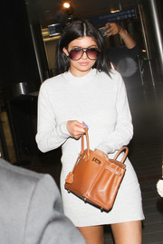 Kylie Jenner accessorized with a pair of old-school shades.