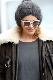 Kylie Minogue livened up her winterwear with a pair of playful white sunglasses.