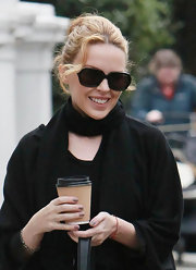 Kylie Minogue finished off her monochromatic look with classic black rectangular sunglasses.
