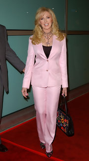 Morgan Fairchild looked like Barbie in a pink pantsuit at the premiere of 'How to Lose a Guy in 10 Days.'