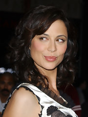 Voluminous curls and side-swept bangs gave Catherine Bell a sweet aura.
