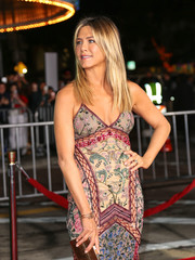 Jennifer Aniston teamed some gold bangles with a boho dress for the LA premiere of 'Office Christmas Party.'