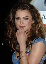 Kerri plays it up by wearing multiple gold bracelets at the premiere.