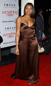 Not one to shy away from daring fashion moves, Taraji sports a brown silk jumpsuit to the 'Something New' premiere in Hollywood.