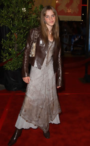 Emma dons a crisp brown leather jacket over her maxi dress at the 'Harry Potter' premiere.