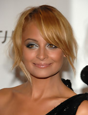 Nicole Richie's topaz-colored eyes pop with shimmery metallic eyeshadow.