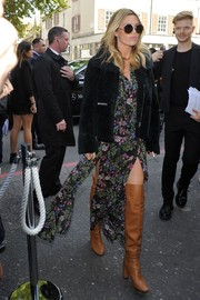 Abbey Clancy looked breezy-sexy in a floral dress with double thigh-high slits during the Topshop Unique fashion show.