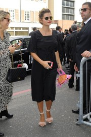 Fluffy pink ankle-strap sandals finished off Pixie Geldof's look in playful style.