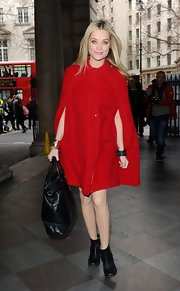 Laura Whitmore complemented her chic red coat with an oversized black leather tote when she attended the Julien MacDonald fashion show.