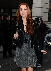 Una Healy paired a black biker jacket over her girlie sequin dress while attending the Julien Macdonald runway show in London.