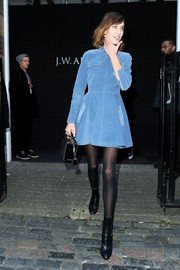 Alexa Chung left the J.W. Anderson fashion show looking adorable in a blue corduroy skater dress from the brand.