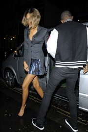 Jourdan Dunn headed to dinner at Mr. Chow looking sharp in a gray Dior coat dress. The shimmery blue panel kept the dress from being too business-y.