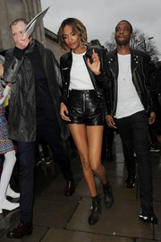 Jourdan Dunn arrived for the Topshop fashion show rocking a black leather short suit.