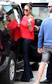 La La Vazquez embraced brights and color-blocking in a loose orange and pink top.