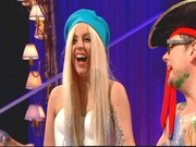 Lady Gaga appeared on 'The Alan Carr Show' wearing a turquoise beret and a strapless white dress.