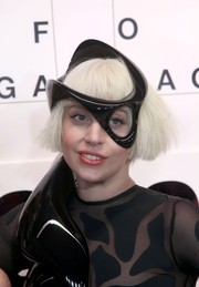 Lady Gaga topped off her look with a futuristic black headpiece.