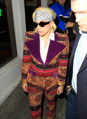 Lady Gaga kept her coiffure in place with a printed head scarf.